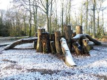 Wooden play area den in winter snow, Chorleywood Common stock photo