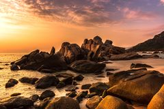 Nature Seascape with Boulders, Beach and Dramatic Clouds at Sunrise stock photos