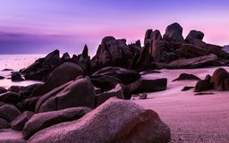 Nature Seascape with Boulders, Beach and Ultraviolet Colors before Sunrise stock image