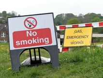 No smoking and gas emergency works signs stock photos