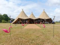 Three large tepees set up for a wedding event on farmland stock photos