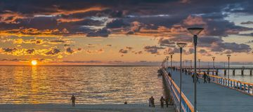 Palanga, Lithuania - October 03, 2013: Marine walking pier in Palanga, Lithuania. The photo was taken during colorful sunset in a famous Baltic resort Palanga Stock Photography