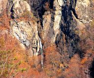 Gardului waterfall through autumn colors stock image