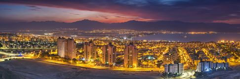 Nocturnal aerial scenic view on Eilat Israel and Aqaba Jordan Royalty Free Stock Photo