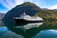 A Cruiseship and Mountains at Geiranger Fjord in Norway royalty free stock image