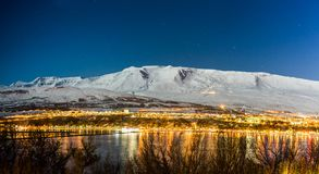 Panoramic view on Akureyri city night in winter with snow at nig royalty free stock photos