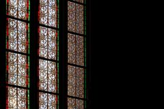 Colorful lead-glass patterns in a gothic church royalty free stock photo