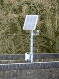 Solar powered camera on railway bridge stock image