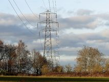 Electricity pylons crossing fields stock photos