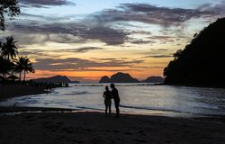 A Couple on the beach of El Nido, Philippines. This photo was taken in Palawan island. El Nido Palawan Philippines has some of the most beautiful scenery we have royalty free stock photo