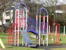 Red and blue metal playground climbing frame royalty free stock image