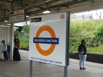 Willesden Junction London Overground railway roundel sign on platform stock image