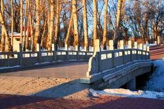 The bridge in the park sunrise. The photo was taken in Yuting park of Nehe, Qiqihar city Heilongjian province, China royalty free stock image