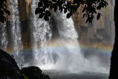 Water fall in forest and rainbow in Guatemalan mountains stock photo