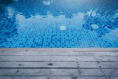 Photo of Water in a swimming pool with sunny reflections and woo stock image