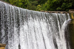 Photo of the waterfall with foaming water Stock Image
