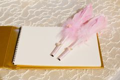 Photo of a wedding register and feather pen. Wedding guestbook. Photo of a wedding register and feather pen. Wedding guestbook create idea stock images
