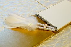 Photo of a wedding register and feather pen. Wedding guestbook. Photo of a wedding register and feather pen. Wedding guestbook create idea stock photos