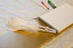 Photo of a wedding register and feather pen. Wedding guestbook. Photo of a wedding register and feather pen. Wedding guestbook create idea royalty free stock photo
