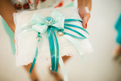 Photo of wedding rings on background of wedding attributes Stock Photo