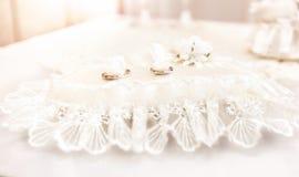 Photo of wedding rings lying on white cushion Royalty Free Stock Photography