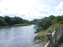 Photo of a welsh river uk. Landscape photo of the popular welsh river teifi  in west wales uk, set in a beautiful  wildlife centre with very old man made fencing Royalty Free Stock Photos