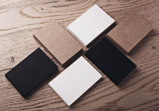 Photo of white, black and craft business cards on wood table. Horizontal Stock Photography