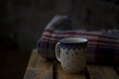 Photo of White and Blue Ceramic Cup on Brown Wooden Surface Royalty Free Stock Photo