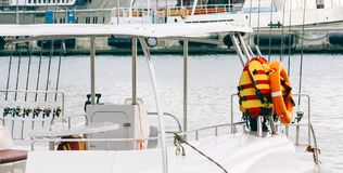 Photo of White Boat With Life Vest on Side stock photos