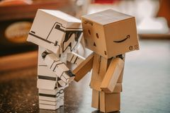 Photo of White, and Brown Cardboard Box Toy Figure royalty free stock photography