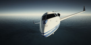 Photo of White Luxury Generic Design Private Jet Flying in Sky at night. Blue Ocean Background. Business Travel Picture Stock Photography