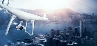 Photo White Matte Generic Design Remote Control Air Drone with action camera Flying Sky under City. Modern Megapolis Royalty Free Stock Images
