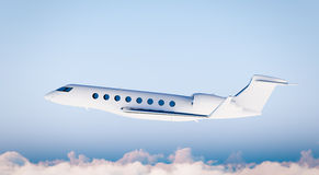 Photo White Matte Luxury Generic Design Private Airplane Flying in Blue Sky.Clear Mockup Isolated on Blurred Background Stock Image