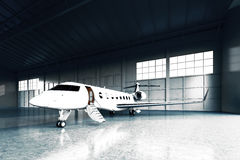 Photo of White Matte Luxury Generic Design Private Jet parking in hangar airport. Concrete floor. Business Travel Stock Image