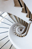 Photo white spiral staircase with many steps and interesting geo Stock Images