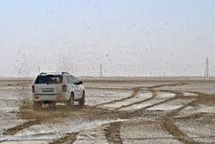 Photo of White Suv on Muddy Plain Stock Photography