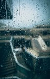 Photo through window with drops at rainy day Stock Image