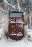 Architecture in winter. Photo of a winter cityscape. Old architecture under deep snowdrifts. Doors and windows Royalty Free Stock Images