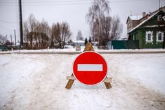 Photo of winter road with prohibition sign Stock Photography