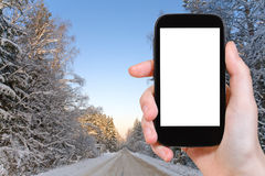 Photo of winter road in snowy russian forest Royalty Free Stock Image