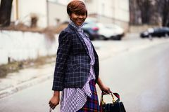 Photo of Woman in Black and Gray Blazer Holding Bag Royalty Free Stock Image