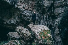 Photo of Woman In Black Outfit Standing On Rock Stock Image