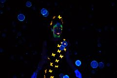 Photo of woman with blue luminous bubbles Stock Photography