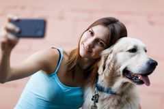 Photo of woman doing selfie with dog stock images