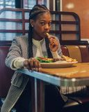 Photo of a Woman Eating at the Restaurant Stock Image