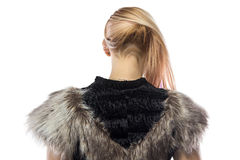 Photo of woman in fake fur jacket,  turned back Royalty Free Stock Images
