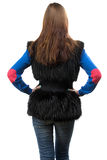 Photo of woman in fake fur waistcoat from the back Stock Photography