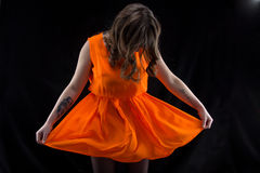 Photo woman with head down, orange dress Royalty Free Stock Photography