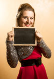 Photo of woman holding blackboard with copyspace Stock Images