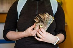 Photo of woman holding in hands folded bundle of money in cash of Nepalese rupees. tourist woman cash money in exchange. Thamel royalty free stock photography